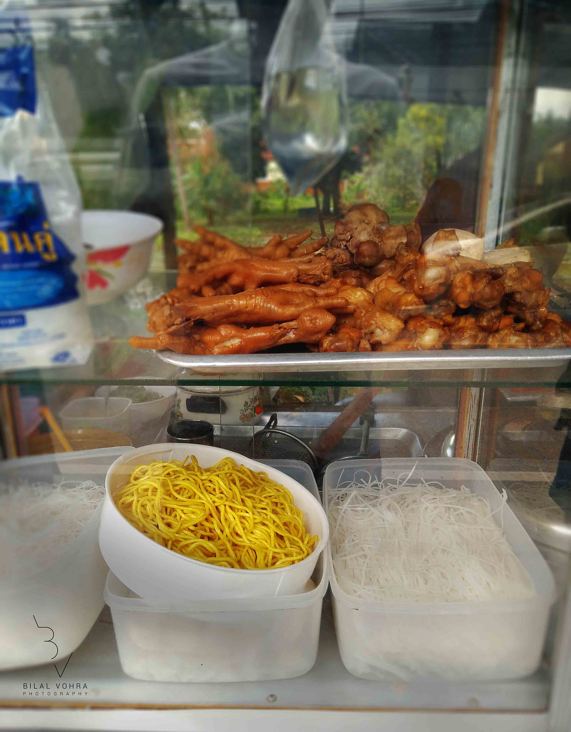 Chicken Feet, Chicken Legs and Boiled Noodles street food from Phuket