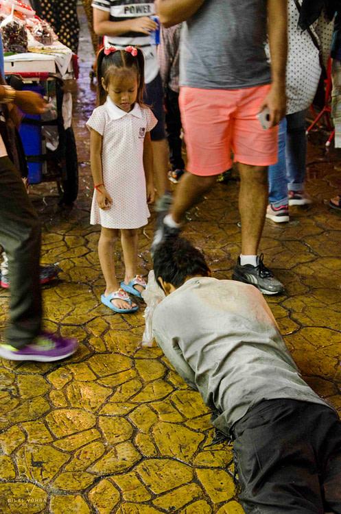 Kid looking at beggar