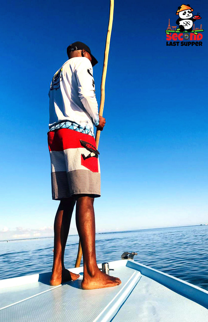 Fisher Man Rowing Boat in Mauritius