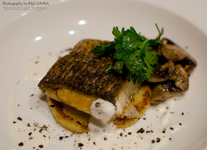 an seared Seabass potato gnocchi with mushrooms in a lemon butter sauce