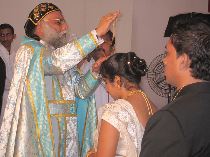 Priest Blessing a Bride