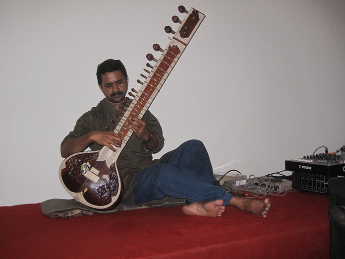 sitar player at the wedding